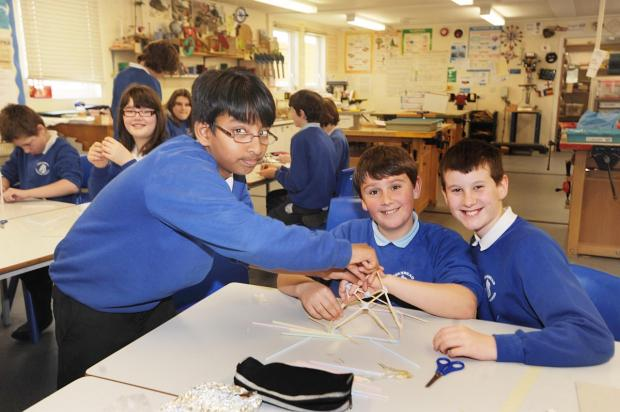 Shariful Haque, Callum Rice and Cameron Riley build a shake-proof structure.