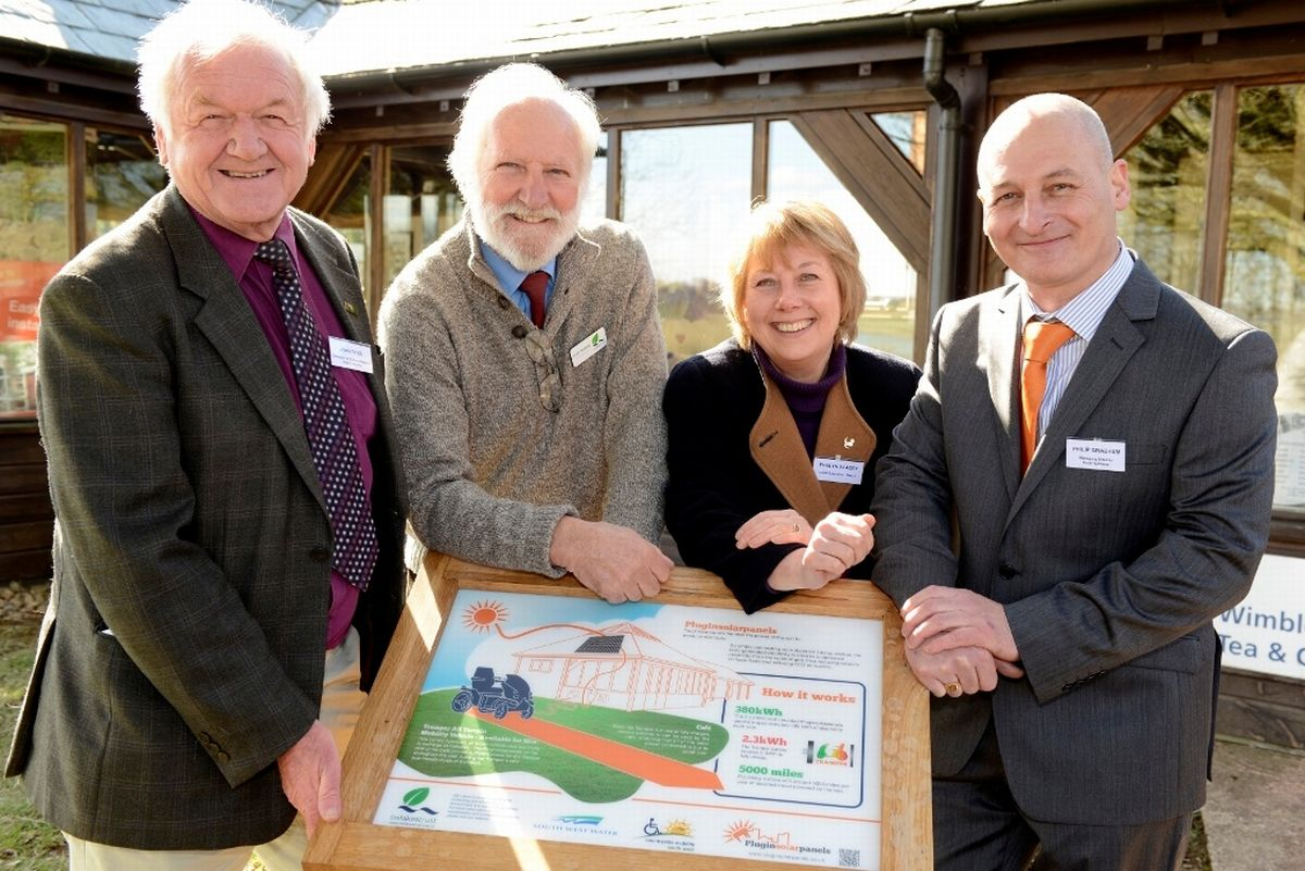JOHN Dyke, chairman of the Exmoor National Park Authority, Keith Bungay, chairman of the South-West Lakes Trust, Evelyn Stacey, chief executive of the SWLT, and Phil Grabham, managing director of Solar Systems at Wimbleball Lake. PHOTO: Submitted.
