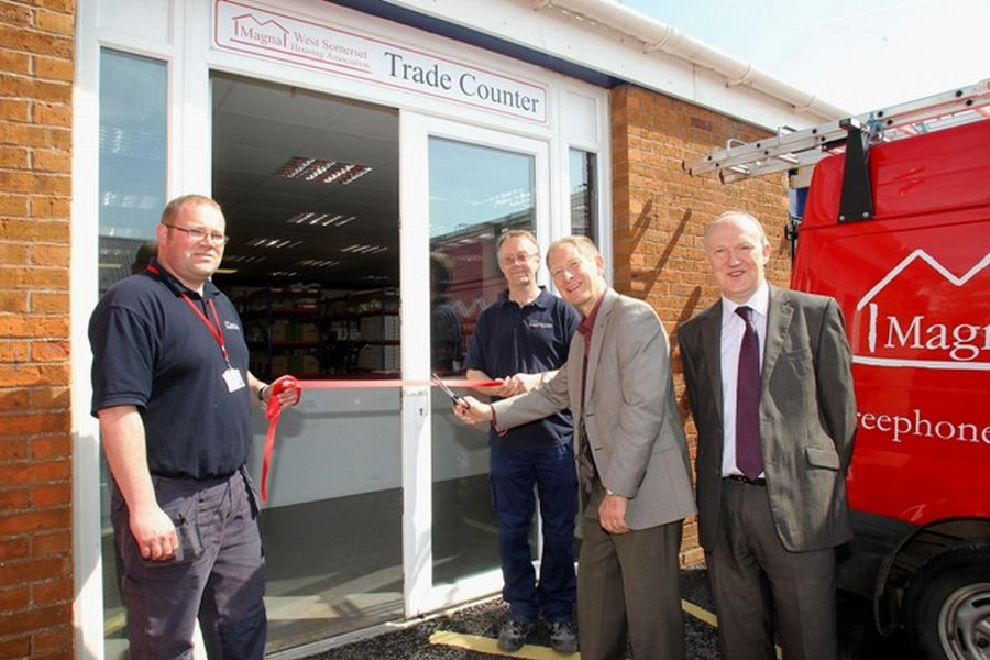 DONALD Rushton, board member, cuts the ribbon with Nicholas Blackshaw (l