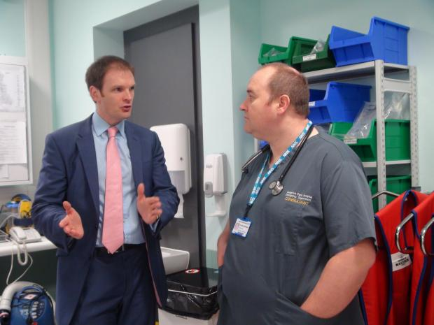 HEALTH Minister Dr Dan Poulter talking to emergency medicine consultant Alistair Billington.