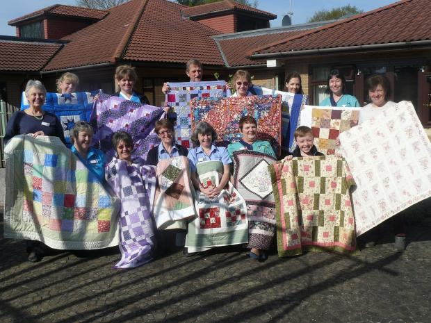 Quilters' gift to St Margaret's Hospice patients