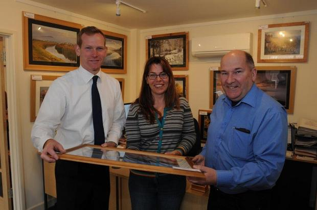 Taunton Deane MP Jeremy Browne, left, with Nicola Coate and Don Bishop at one of the attractions at the Willows and Wetlands Centre. Photo: Geoff Roberts.
