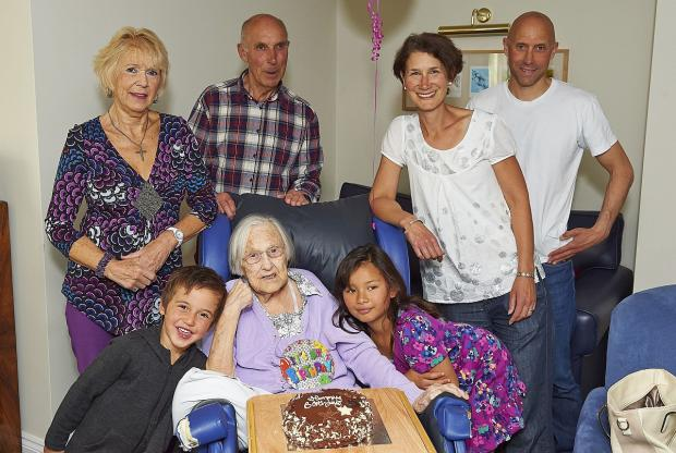 Centenarian Molly Merrifield surrounded by her family for her 100th birthday.