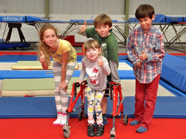 This is The West Country: Thomas, Alex and Emily with Jessica Avery as they raise money to help Jessica walk unaided.
