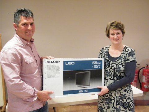 Linda Parker receiving a donation of an LCD TV presented by Paul Stoked of EDF