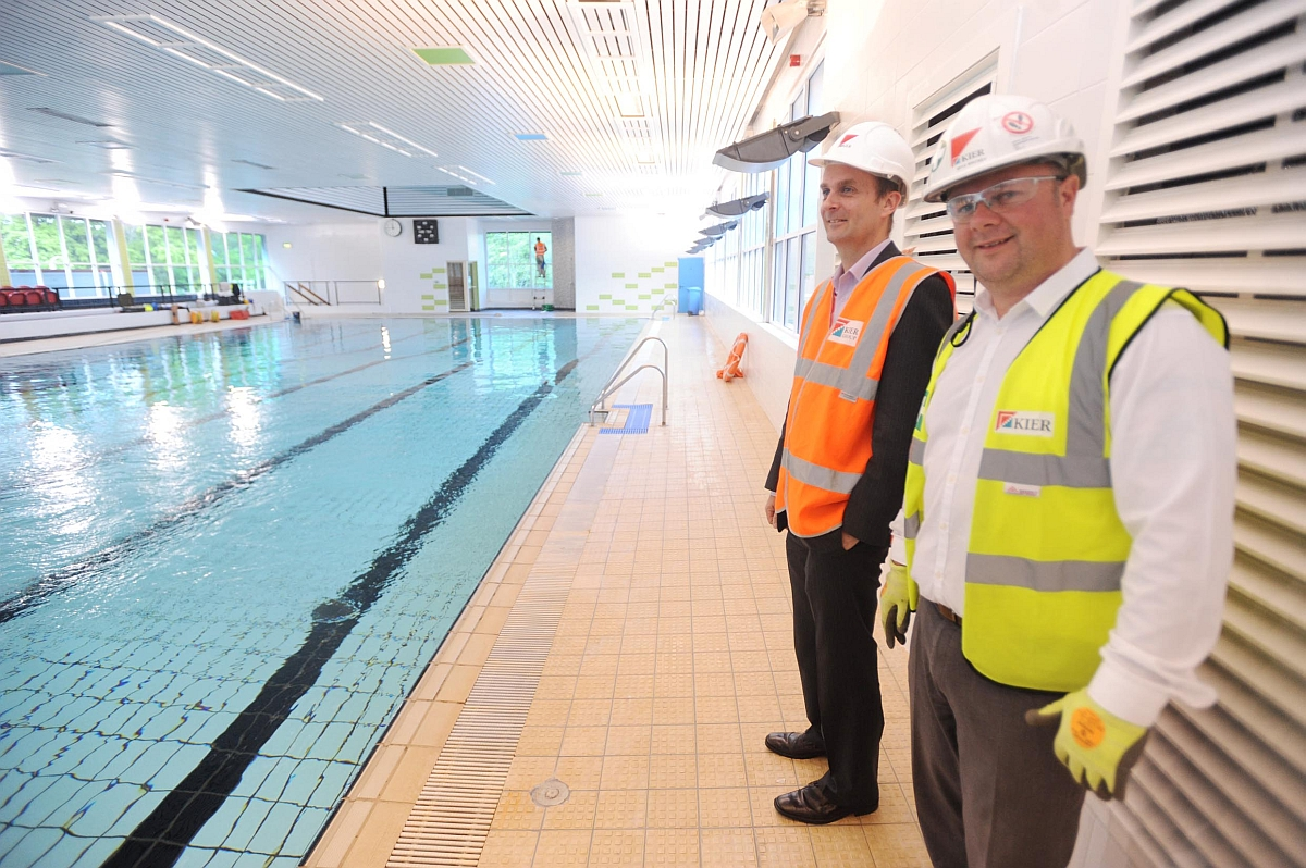 Workers from Kier stand by the pool.