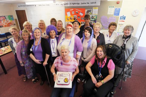The Fibromyalgia support group celebrate with wigs and cakes