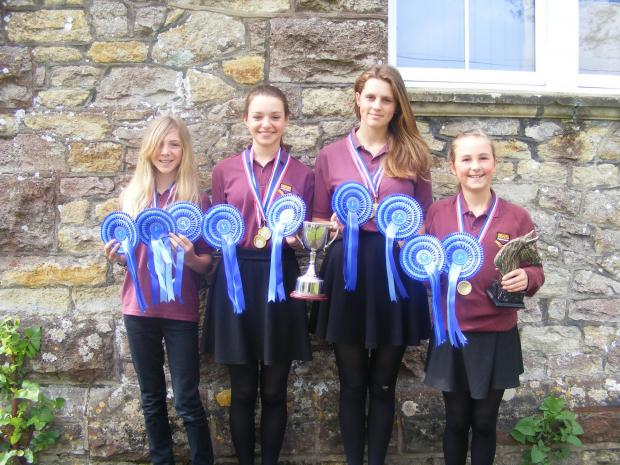 KATIE, Lucy, Emily and Florence with their winnings.