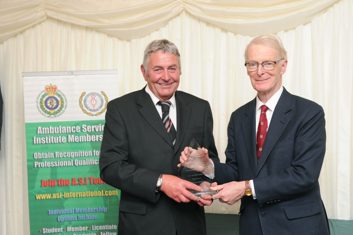 WATCHET hero George Reeder receives his award from Lord McColl at the House of Lords. PHOTO: Submitted