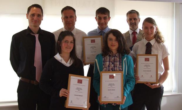 Students collect their awards from the Taunton Chamber of Commerce.