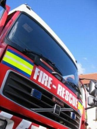 Fire crews rescue woman after car overturns