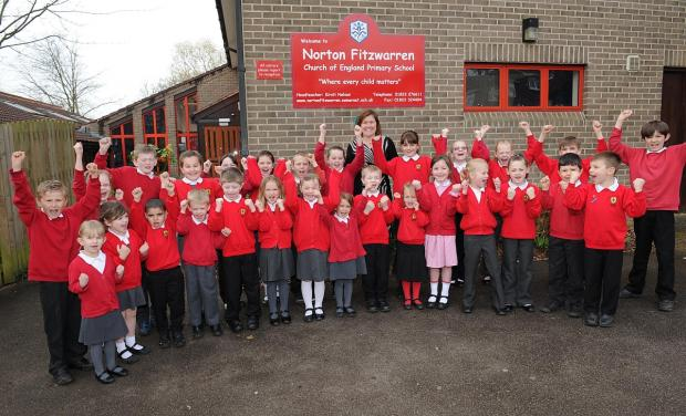 Head teacher Kirsti Nelson and pupils celebrate Ofsted's judgement.