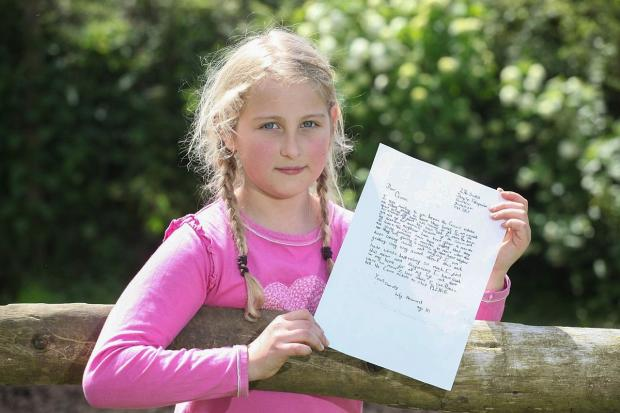Lily Howard with her letter to the Queen.