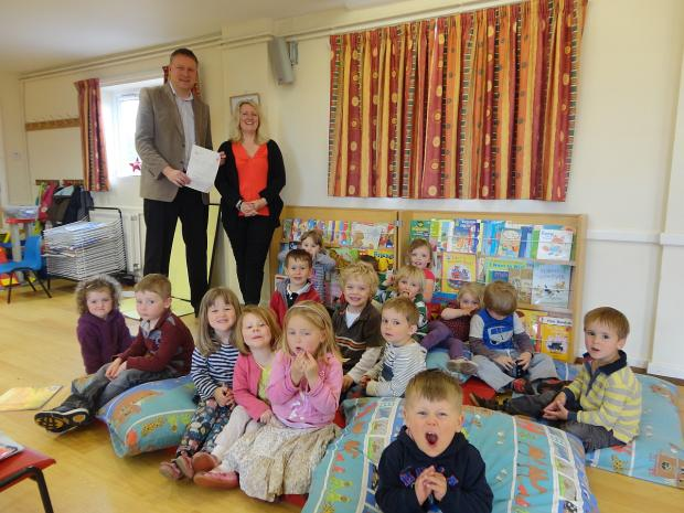 This is The West Country: Cllr Ross Henley, rear left, with pre-school manager Angela Wills and children.