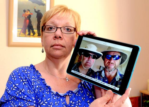KAY Coombes with a photograph of her brother Steve Warren (right) and his friend Paul Goslin, both lost in the Atlantic.