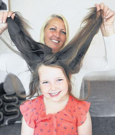 Mum Joanne with Shannon O'Reilly, who is set to lose her locks