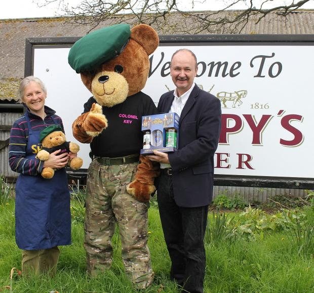 Louisa Sheppy, of Sheppy's, and Stephen Heptinstall, of Cotleigh, celebrate their commemorative brews with Go Commando's Col Kev Ted.