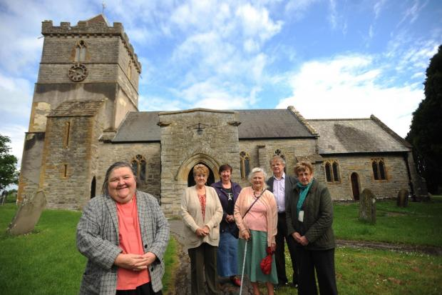 Rev Doris Goddard with church goers, hoping to raise the funds to save their church tower