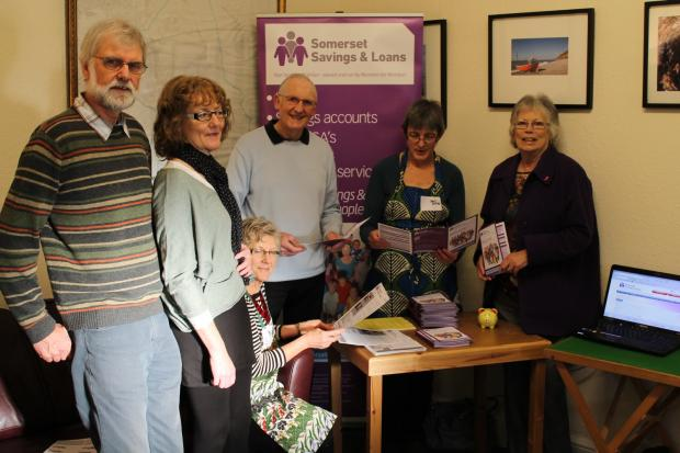 Gill Hull (far right) with members and friends of Somerset Savings and Loans at the credit union's pop-up stall in Backwell. Photo: submitted.