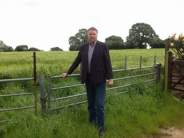This is The West Country: Cllr Ross Henley is pictured in Beech Hill next to the proposed access site to the estate east of Wellington.