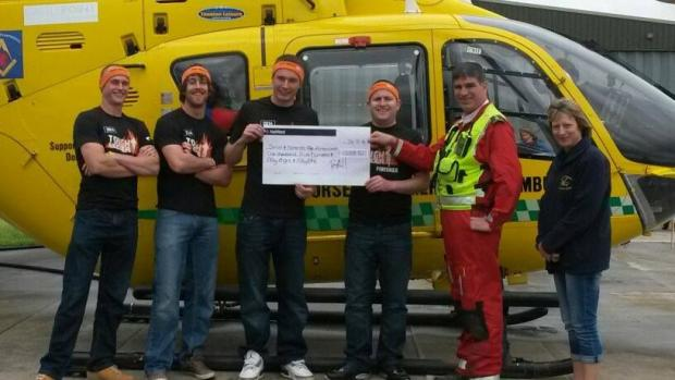PAUL Jury, Sam Pershouse, Tom Giles and Ray Hall hand their cheque to the crew of the air ambulance. PHOTO: Sarah Saffery.
