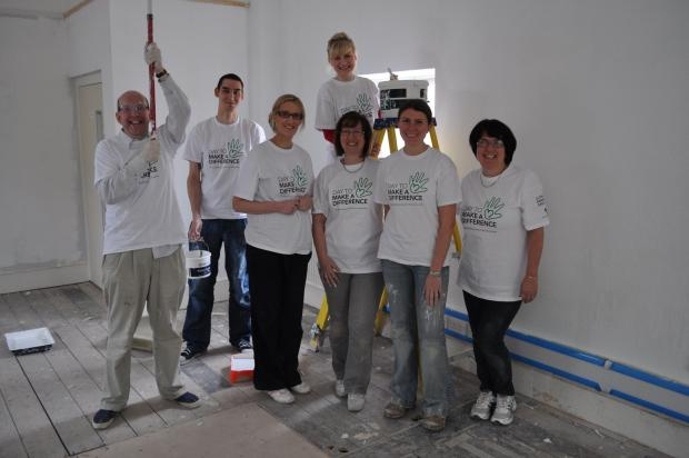 This is The West Country: Lloyds Bank staff helping decorate the new premises.