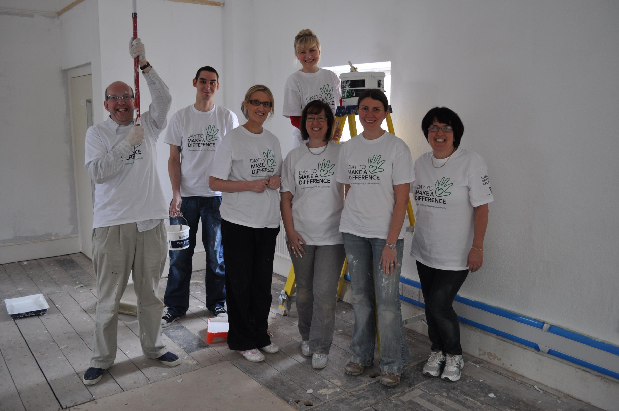 Lloyds Bank staff helping decorate the new premises.