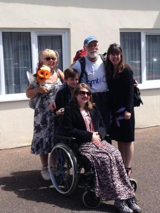JOHN was greeted by wife Annie, daughter Amanda and grandchildren Alex and Abbie after completing his walk. PHOTO: Submitted.