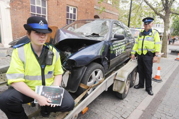 The crash car outside the Market House with PCSOs Ann Devereux and Eamonn Leniston.