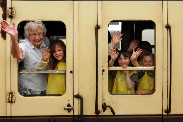 "GIVING a wave with some of the Brownies is Betty Smither, Somerset's most ""senior"" Brownie, who joined Minehead Brownies in 1933. Betty is now chair of the Trefoil Guild, which supports Guiding. PHOTO: Russell Sach."