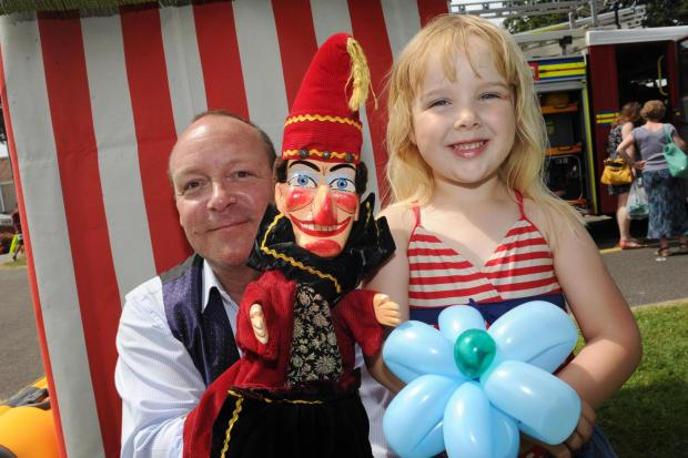 ALL the fun of the fair: this young visitor enjoyed meeting Mr Punch at Victoria Park's summer fair