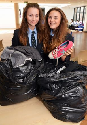 MATERIAL GIRLS: Chilton Trinity students are collecting materials to fund a trip to Africa. Above are Beth Manchip and Rachel Rowland, 14. PHOTO: Jeff Searle