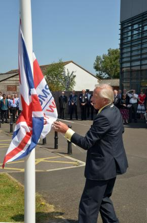 WEST Somerset Council chairman Cllr Stuart Dowding, raising the flag outside West Somerset House. PHOTO: Somerset Photo News
