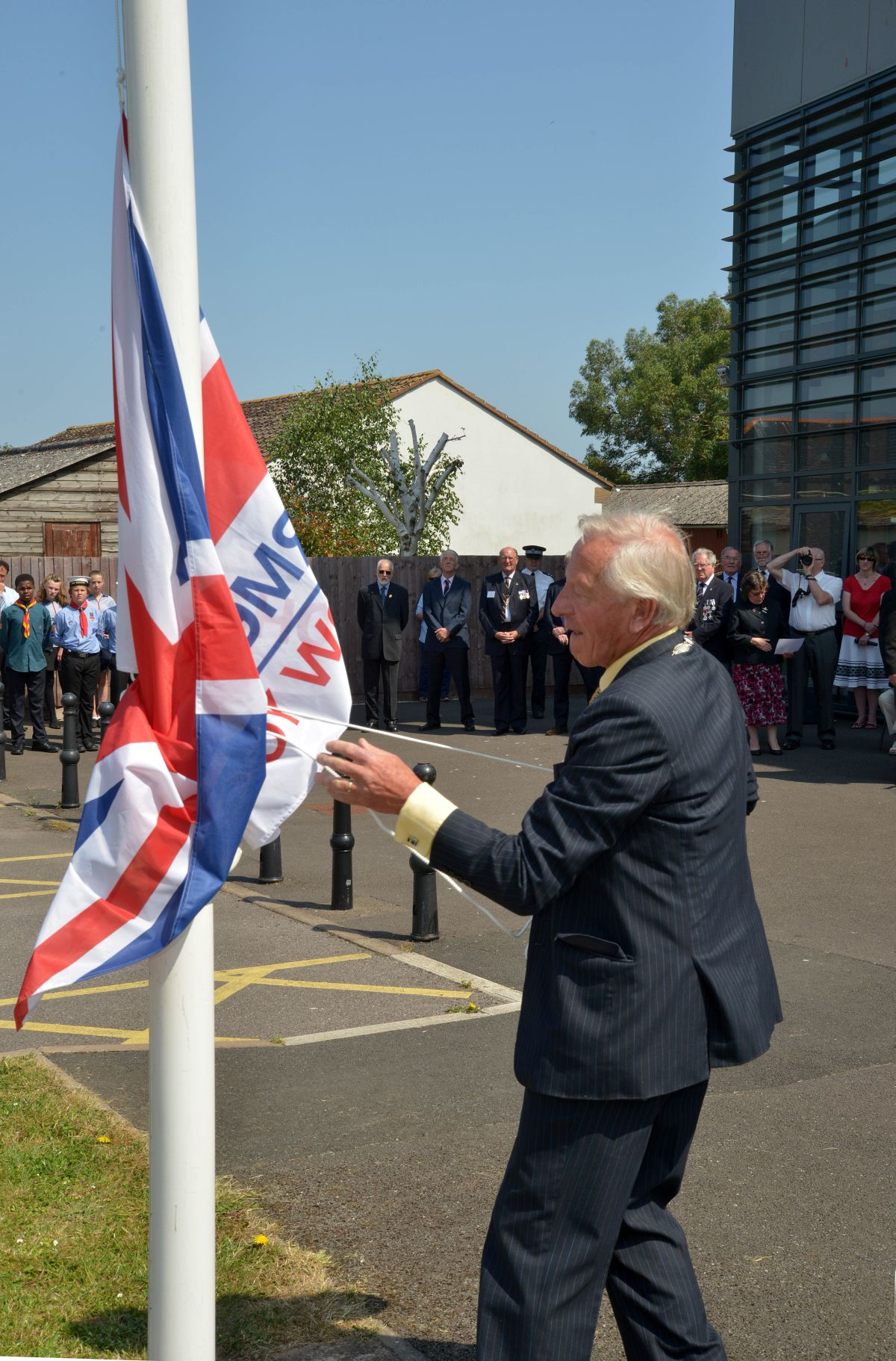 WEST Somerset Council chairman Cllr Stuart Dowding, raising the flag outside West Somerset House. PHOTO: Somerset Photo New