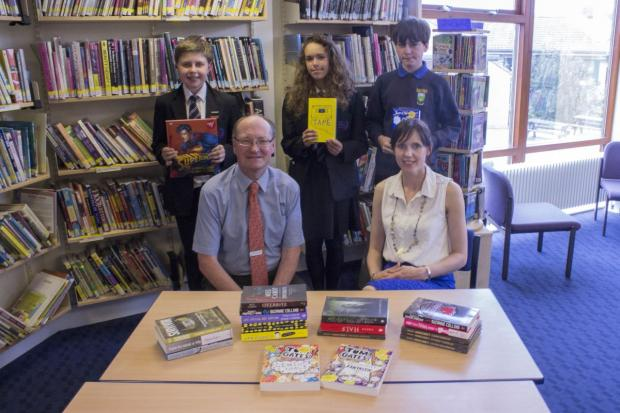 FROM left, back, Jamie Savage, Yasmina Bache and James Fitzmaurice; front, Minehead WHSmith manager Malcolm Adams and college library manager Jo Crossman. PHOTO: