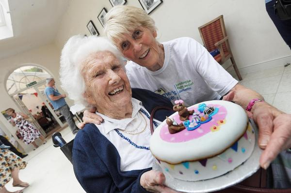 Mary Hyde with Caroline Martin, who held a 'guess the cake weight' competition in aid of the Alzheimer's Society.