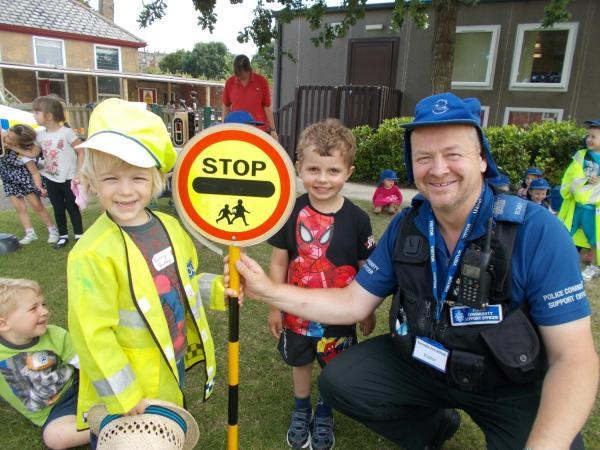 PCSO John Martin with two children from the pre-school