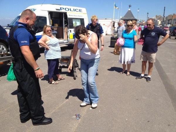 MEMBERS of the public trying the 'beer goggles' which replicate being drunk. It's not so easy to pick the keys up.