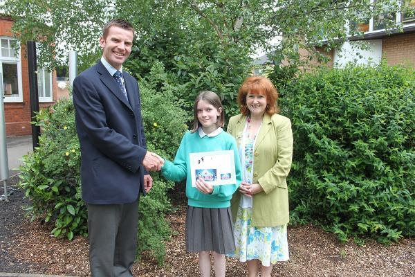 Freya, centre, is pictured being congratulated by Taunton Prep School deputy head Simon Bailey and Jayne Hornsby, head of expressive arts.
