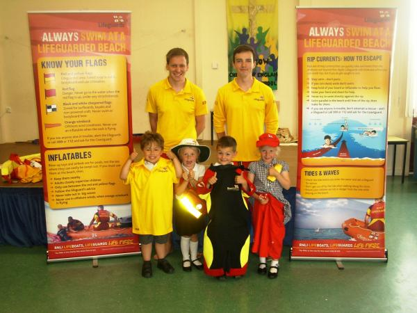 Lifeguards talk to children from Berrow Church of England Primary School. Photo: RNLI.