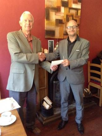 Unite Carers trustee Roy Grantham (left) collects the cheque from Mid Devon Network chairman Paul Webber.