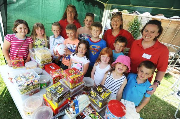 This is The West Country: PTFA members and children at the summer fair.