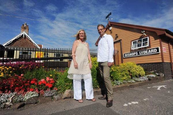 SINGER Sarah Randle and Giles Adams in Bishops Lydeard at the West Somerset Railway, which features in his video.