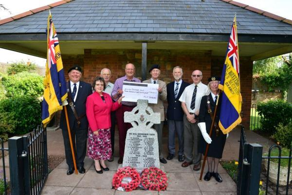 FLYING START: Members of the Royal British Legion, Williton branch, and the Williton Remembers WW1 project receive the Heritage Lottery cheque which will enable them to put their plans into action. PHOTO: Somerset Photo News.