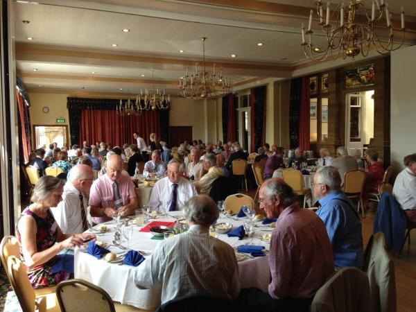 OLD Ilminsterians sit down for a meal during their reunion.