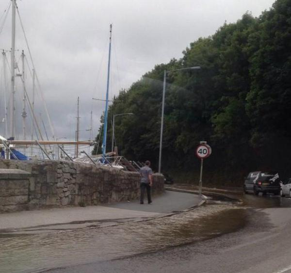 Suspected burst water main leaves Penryn's Commercial Road underwater