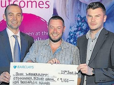 JOSH Wedderkopp (centre) receives the grant cheque. Photo: Submitted