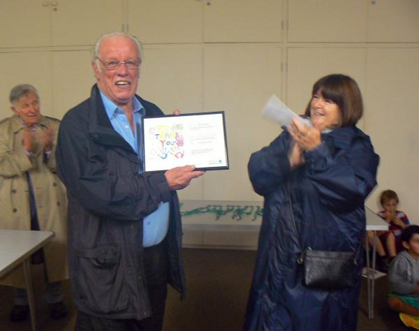 MOIRA Smyth, chairman of the NSPCC West Somerset fundraising branch, presents Roy Coates with a certificate of thanks. PHOTO: Ron Fitzer.