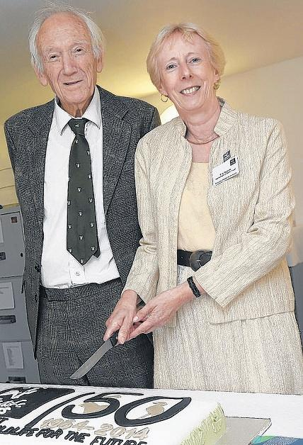 BERNARD Storer and Eve Tigwell cut a cake to celebrate the 50th anniversary of the trust