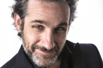 Dark and edgy - Canadian comic Tom Stade is heading back to Comedy Hall in Tiverton